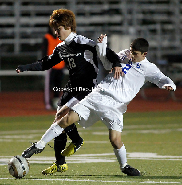 Southbury, CT-04 November 2012-110412CM15-   Pomperaug's Jung Kang, left, and Brookfield's Steven Almeida, battle for the ball during SWC tournament action Sunday night in Southbury.   Christopher Massa Republican-American