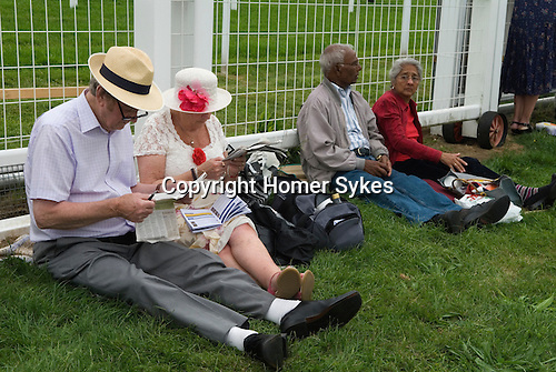 The Derby horse race. Epsom Down Surrey UK. Seniors enjoy a day out at the races.