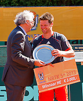 2013-08-17, Netherlands, Raalte,  TV Ramele, Tennis, NRTK 2013, National Ranking Tennis Champ,  Nick van der Meer receives the trophy from Floor Jonkers<br /> <br /> Photo: Henk Koster