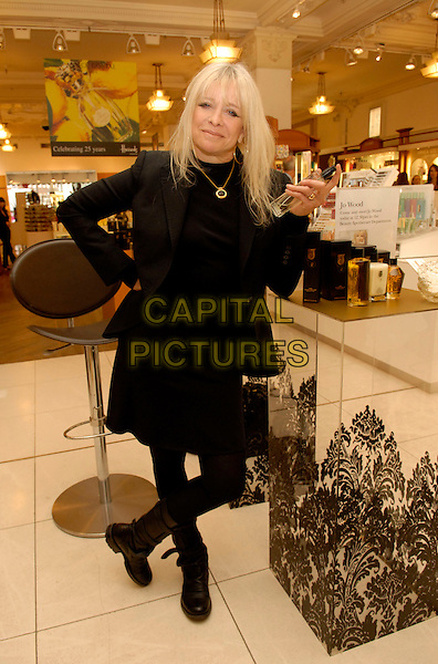 "JO WOOD.At a signing for Jo Wood's ""Naturally"" Organic Beauty products at Harrods, London, England..May 10th, 2007.full length black jacket skirt boots perfume hand on hip.CAP/FIN.©Steve Finn/Capital Pictures"