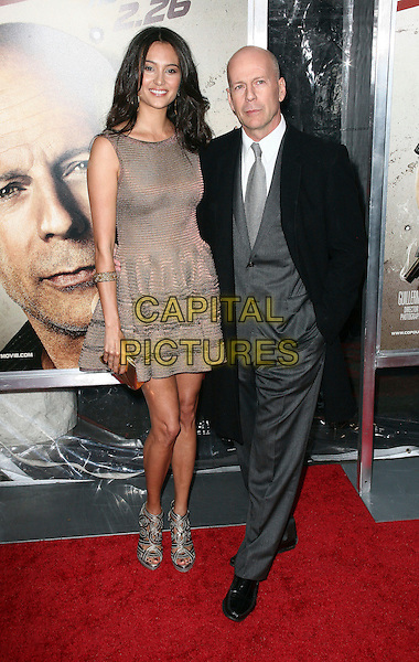 "EMMA HEMING & BRUCE WILLIS .World  Premiere of ""Cop Out"" at AMC Loews Lincoln Square 13 in New York City, NY, USA, 22nd February 2010..arrivals full length married couple husband wife couple gold dress sleeveless bronze white shirt grey gray silver tie black coat trousers cut out sandals metallic clutch bag shoes suit .CAP/ADM/PZ.©Paul Zimmerman/Admedia/Capital Pictures"