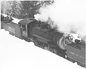 3/4 elevated view of C&amp;TS #483 pushing on a rotary snowplow train east of Chama.<br /> C&amp;TS  e. of Chama, NM