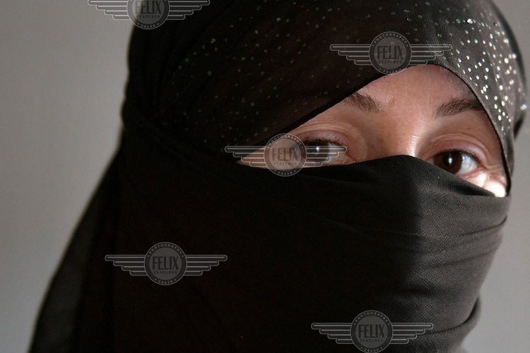 A portrait of a 24 year old Yazidi woman who was captured by Islamic State (IS) on 3 August 2014 and was sold to several fighters during her captivity, including an IS fighter in Raqqa in Syria. She was repeatedly beaten with sticks, given electric shocks  and raped. One day an IS fighter pushed her off the top of the stairs and she fell down, breaking her leg. Then she was told to take a shower and when she refused she was forcibly undressed and made to take a shower. After this she was locked into a room for the night on her own. <br /> Her captor often made her take sleeping pills when he went to Kobane to fight in order to make sure that she wouldn't run away. One day, he asked her if she wanted something from the market. She said - I would like to take sleeping pills. The next morning, she put the pill in his breakfast. When she was sure that the IS fighter was asleep, she covered herself in black clothes and ran away from the house. She took a taxi and gave the driver a mobile she stole from the IS fighter. When she was dropped off by the taxi, she ran to a house and asked people for help. After she had eaten a meal at the house, she walked to the Turkish border. She was finally able to escape from IS in January 2015. Most of her family member including her parents, four brothers and two sister are still in IS captivity.