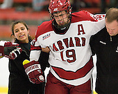 ? and Steve Chouinard (Colgate - Trainer) help Alex Killorn (Harvard - 19) to the Crimson bench. - The Harvard University Crimson defeated the visiting Colgate University Raiders 4-2 on Saturday, November 12, 2011, at Bright Hockey Center in Cambridge, Massachusetts.