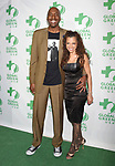 LOS ANGELES, CA - FEBRUARY 22: Former NBA player John Salley (L) and wife Natasha Duffy arrive at the 14th Annual Global Green Pre-Oscar Gala at TAO Hollywood on February 22, 2017 in Los Angeles, California.