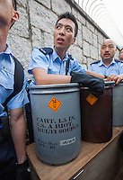Hong Kong police move tear gas, CS handburst grenades, outside the PLA barracks in Hong Kong.   After five days OF mass civil disobedience in Hong Kong the  Occupy Central, aka, The umbrella revolution has reached a stand-off,  Hong Kong, China,02-Oct- 2014