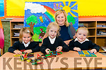 Class teacher and Principal Michelle Murphy with her new junior infants Isabelle O'Sullivan, Caitlin Cronin and Clodagh Cahill on their first day of school at Shrone NS last Monday.