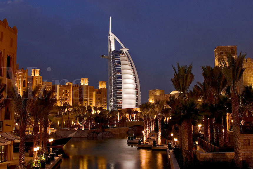 Dubai, United Arab Emirates. Madinat Jumeirah. Burj al Arab Hotel, .Mina A'Salam Hotel and Convention Centre. Souk. Evening..