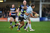Jonathan Joseph of Bath Rugby tackles Ryan Mills of Worcester Warriors. Aviva Premiership match, between Bath Rugby and Worcester Warriors on December 27, 2015 at the Recreation Ground in Bath, England. Photo by: Patrick Khachfe / Onside Images