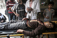 In this Thursday, Nov. 01, 2012 photo, a lifeless body of a Syrian children lays down on a trolley at the entrance of one hospital as it arrives dead by a mortar shell explosion in the nearby Tarik Al-Bab neighborhood in Aleppo, the Syrian's largest city. (AP Photo/Narciso Contreras).