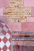 Detail of pink stone and brick wall of the Cathedral of the Immaculate Conception in downtown Mazatlan, Sinaloa, Mexico