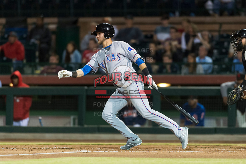 Surprise Saguaros designated hitter Charles Leblanc (12), of the Texas Rangers organization, starts down the first base line during an Arizona Fall League game against the Scottsdale Scorpions at Scottsdale Stadium on October 15, 2018 in Scottsdale, Arizona. Surprise defeated Scottsdale 2-0. (Zachary Lucy/Four Seam Images)
