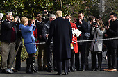 United States President Donald J. Trump greets guests while departing the White House December 8, 2018 in Washington, DC. Trump announced White House Chief of Staff John Kelly will resign by the end of the year before departing for the 119th Army-Navy Football Game in Philadelphia, Pennsylvania. <br /> Credit: Olivier Douliery / Pool via CNP