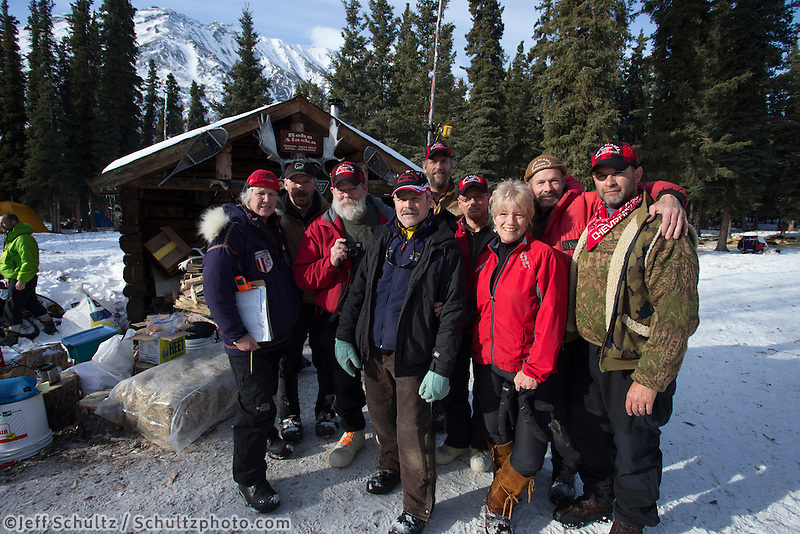 Some of the volunteers at the Rohn checkpoint pose for a photo during the 2013 Iditarod sled Dog Race   March 5, 2013...Photo by Jeff Schultz Do Not Reproduce without permission