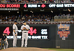 (L-R) Derek Jeter, Masahiro Tanaka (Yankees),<br /> JULY 3, 2014 - MLB :<br /> Derek Jeter of the New York Yankees talks with pitcher Masahiro Tanaka on the mound in the seventh inning during the Major League Baseball game against the Minnesota Twins at Target Field in Minneapolis, Minnesota, United States. (Photo by AFLO)