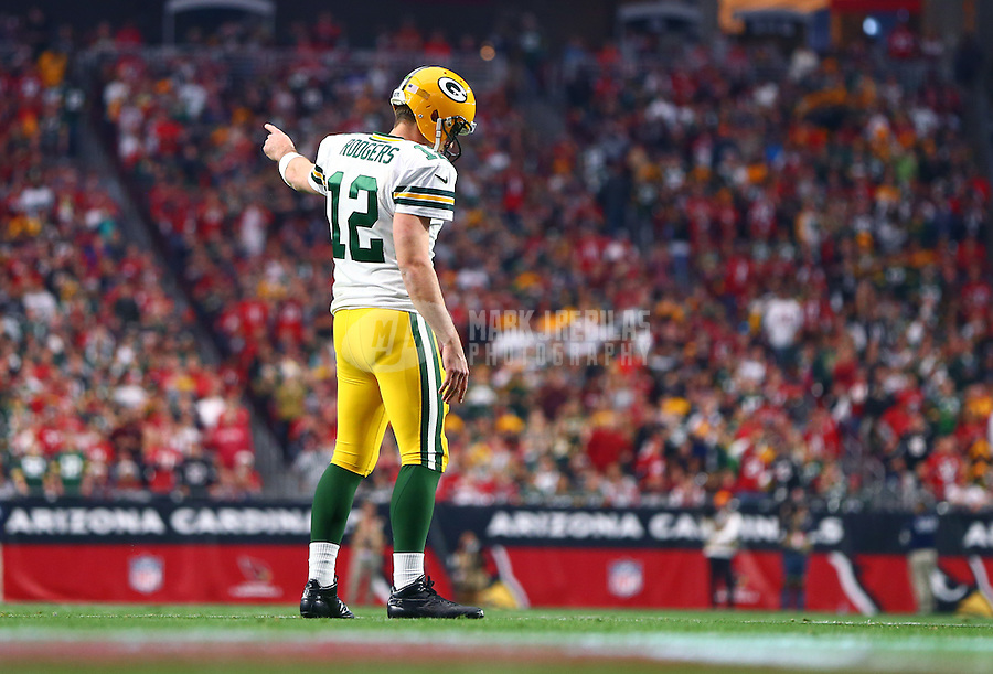 Dec 27, 2015; Glendale, AZ, USA; Green Bay Packers quarterback Aaron Rodgers (12) reacts against the Arizona Cardinals at University of Phoenix Stadium. The Cardinals defeated the Packers 38-8. Mandatory Credit: Mark J. Rebilas-USA TODAY Sports