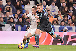 Real Madrid's Lucas Vazquez and Real Sociedad's Kevin Rodriguez during La Liga match between Real Madrid and Real Sociedad at Santiago Bernabeu Stadium in Madrid, Spain. January 29, 2017. (ALTERPHOTOS/BorjaB.Hojas)