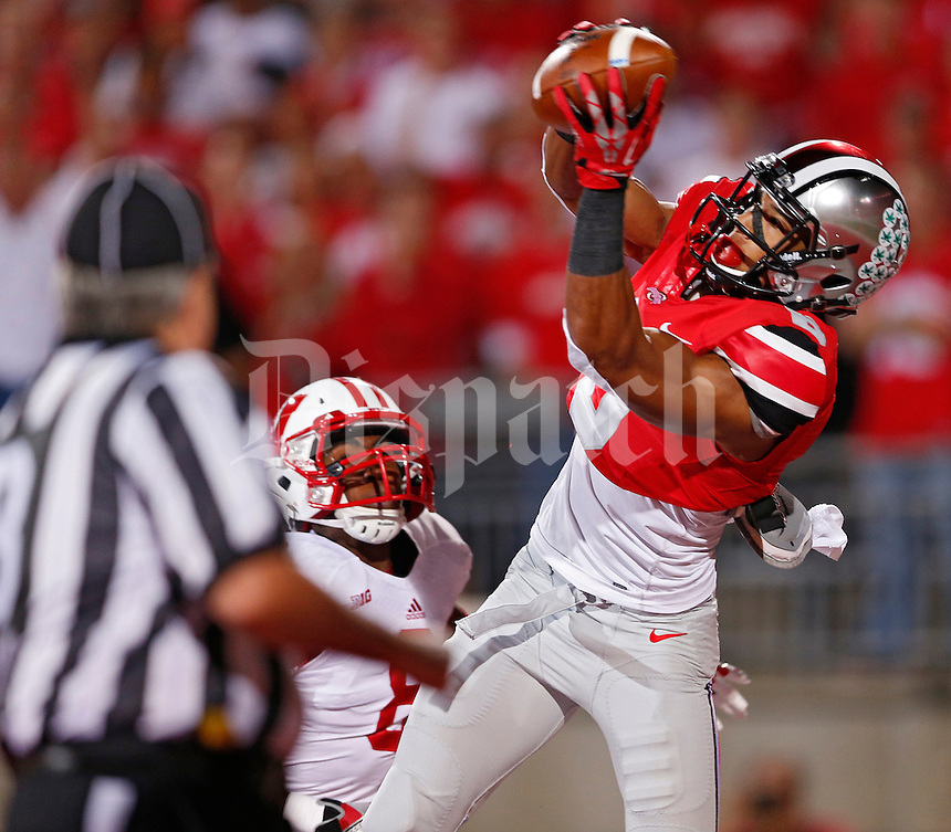 Ohio State Buckeyes wide receiver Evan Spencer (6) catches the first touchdown of the night against  Wisconsin Badgers cornerback Sojourn Shelton (8)at Ohio Stadium on September 28, 2013.  (Chris Russell/Dispatch Photo)
