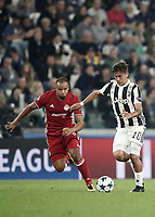 Football Soccer: UEFA Champions League Juventus vs Olympiacos Allianz Stadium. Turin, Italy, September 27, 2017. <br /> Juventus' Paulo Dybala (r) in action with Olympiacos' Vadis Odjidja (l) during the Uefa Champions League football soccer match between Juventus and Olympiacos at Allianz Stadium in Turin, September 27, 2017.<br /> UPDATE IMAGES PRESS/Isabella Bonotto