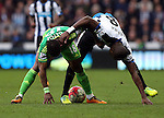 Sunderland's Jermain Defoe, left, vies for the ball with Newcastle United's Chancel MBemba, right, during the Barclays Premier League match at St James' Park Stadium. Photo credit should read: Scott Heppell/Sportimage