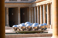 Sculpture at the Palais Royale in Paris. Chrome silver spheres balls and fountain by Pol Bury reflecting many times the Palais Royale building. Paris France Europe