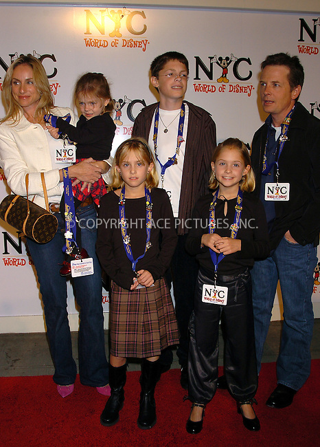 WWW.ACEPIXS.COM . . . . .  ..NEW YORK, OCTOBER 4, 2004: Michael J. Fox, wife Tracy Pollan and their children attending the grand opening of the World of Disney Flagship Store...Please byline: AJ Sokalner - ACE PICTURES..... *** ***..Ace Pictures, Inc:  ..Alecsey Boldeskul (646) 267-6913 ..Philip Vaughan (646) 769-0430..e-mail: info@acepixs.com..web: http://www.acepixs.com
