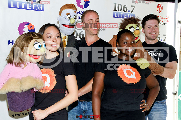 """NEW YORK - AUGUST 16: Cast of """"Avenue Q"""" backstage during 106.7 Lite FM Presents Broadway in Bryant Park on August 16, 2012 in New York City. (Photo by MPI81/MediaPunchInc)"""