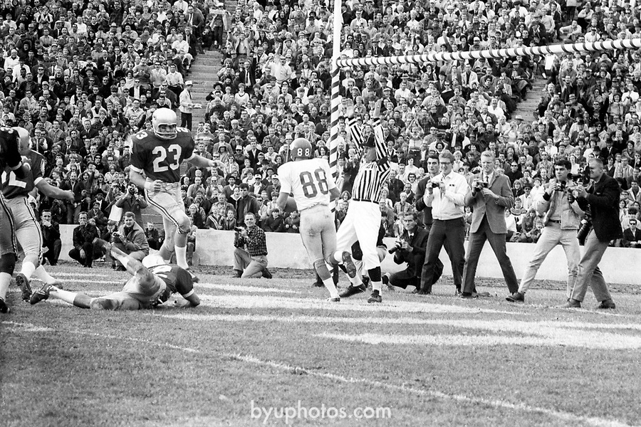 FTB 06 A 15 Utah<br /> <br /> Football BYU-Utah (at SLC), Kent Oborn's TD Series, Paul Erhman, Max Newberry. 88 Phil Odle.<br /> <br /> Nov. 12, 1966<br /> <br /> Box Number: 6373<br /> <br /> Photo by: Hal Williams/BYU<br /> <br /> Copyright BYU PHOTO 2008<br /> All Rights Reserved<br /> 801-422-7322<br /> photo@byu.edu