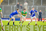 John Mitchels Bryan Costello tries to get passed St Mary's Adam Walsh and Sean O'Shea in the Intermediate Club Championship at Austin Stack park, Tralee on Sunday.