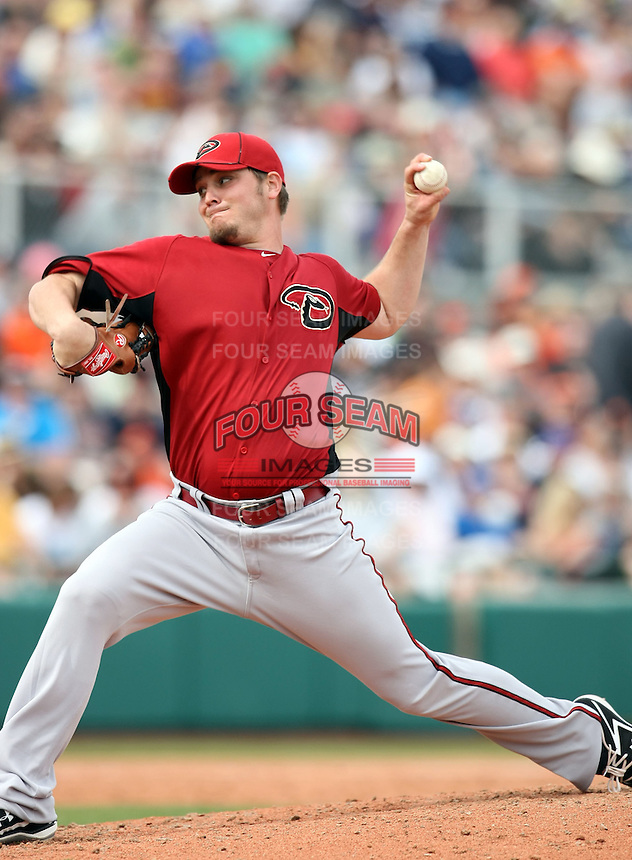 Wade Miley #67 of the Arizona Diamondbacks pitches against the San Francisco Giants in the first spring training game of the season at Scottsdale Stadium on February 25, 2011  in Scottsdale, Arizona. .Photo by:  Bill Mitchell/Four Seam Images.