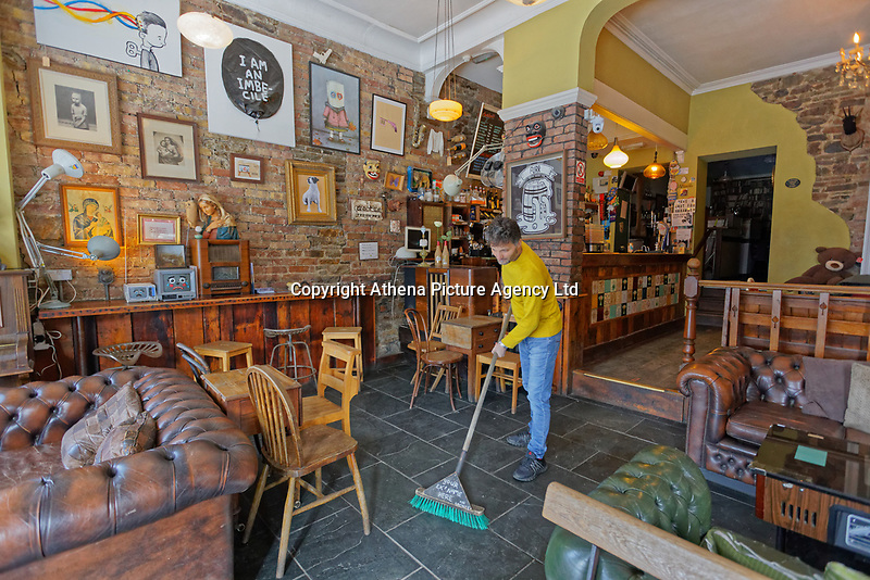 Pictured: Manager Levente Jakab, who has been doing maintenance work at Noah's Yard bar and cafe which had to close down, following instructions from Government, in the Uplands area in Swansea, Wales, UK. Saturday 21 March 2020<br /> Re: Covid-19 Coronavirus pandemic, UK.