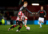 4th January 2020; Griffin Park, London, England; English FA Cup Football, Brentford FC versus Stoke City; Ryan Woods of Stoke City challenges Dru Yearwood of Brentford - Strictly Editorial Use Only. No use with unauthorized audio, video, data, fixture lists, club/league logos or 'live' services. Online in-match use limited to 120 images, no video emulation. No use in betting, games or single club/league/player publications
