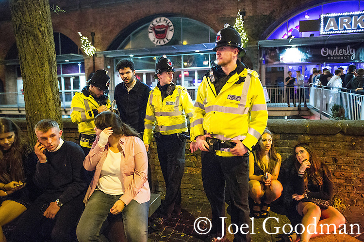 "© Joel Goodman - 07973 332324 . 19/12/2015 . Manchester , UK . Police officers detain a man after another man is punched , at Deansgate Locks . Revellers in Manchester enjoy "" Mad Friday "" - also known as "" Black Eye Friday "" - the day on which emergency services in Britain are typically at their busiest , as people head out for parties and drinks to celebrate Christmas . Photo credit : Joel Goodman"