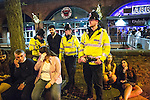 """© Joel Goodman - 07973 332324 . 19/12/2015 . Manchester , UK . Police officers detain a man after another man is punched , at Deansgate Locks . Revellers in Manchester enjoy """" Mad Friday """" - also known as """" Black Eye Friday """" - the day on which emergency services in Britain are typically at their busiest , as people head out for parties and drinks to celebrate Christmas . Photo credit : Joel Goodman"""