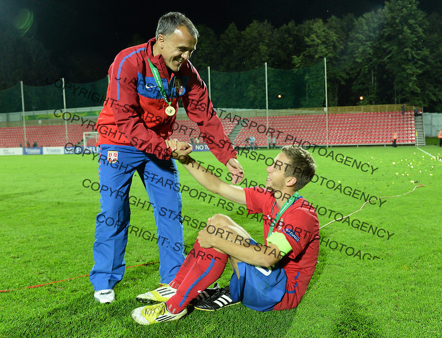 Serbia coach Ljubinko Drulovic with captain Marko Pavlovski after defeating France in their UEFA European Under-19 Championship final