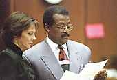 Lead defense attorney Johnnie L. Cochran, Jr., right, and prosecutor Marcia Clark confer during the trial of former NFL star running back O.J. Simpson for the murder of his former wife, Nicole Brown Simpson and a friend of hers, restaurant waiter, Ron Goldman in Los Angeles County Superior Court in Los Angeles, California on July 13, 1995.<br /> Credit: Steve Grayson / Pool via CNP