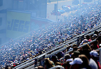 Apr. 14, 2012; Concord, NC, USA: NHRA grandstands packed with fans gets smoked in during qualifying for the Four Wide Nationals at zMax Dragway. Mandatory Credit: Mark J. Rebilas-