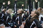 0892                            Megan Miles and the Eagle River cheerleaders perform in a rainstorm at halftime of the Wolves-Wasilla football game Friday, Aug. 18, 2017.  Photo for the Star by Michael Dinneen