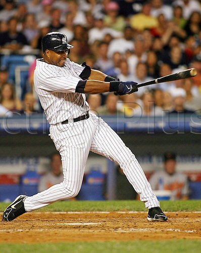 Yankees Bernie Williams hits a double in the 5th inning to take 3rd place on the Yankees all-time players list passing Don Mattingly with 443 doulbes against the Baltimore Orioles at Yankee Stadium in New York, August 16, 2006.
