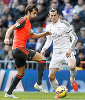 Real Madrid's Garet Bale (r) and Real Sociedad's Xabi Prieto during La Liga match.January 31,2015. (ALTERPHOTOS/Acero) /NortePhoto<br />