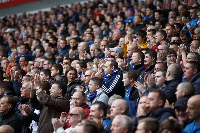 Rangers fans stand and applaud the memory of Sandy Jardine on the second minute