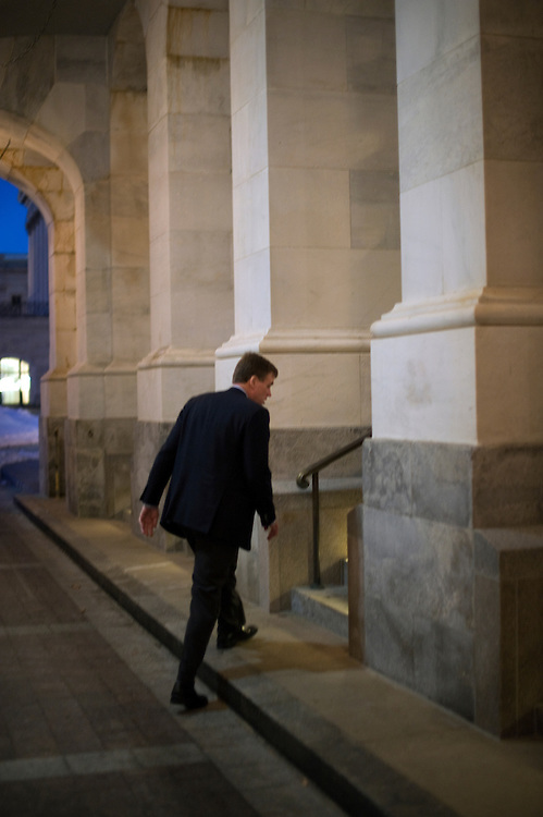 Senator Mark Warner, D-VA., makes his way into the Senate for a Christmas eve vote on passage of the health care reform bill. Dec. 24, 2009.