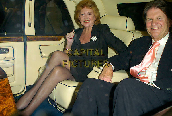 "CILLA BLACK & JOHN MADEJSKI.The ""Cabaret"" press night, Lyric Theatre, London, UK..October 10th, 2006.Ref: CAN.full length sitting car legs crossed.www.capitalpictures.com.sales@capitalpictures.com.©Can Nguyen/Capital Pictures"