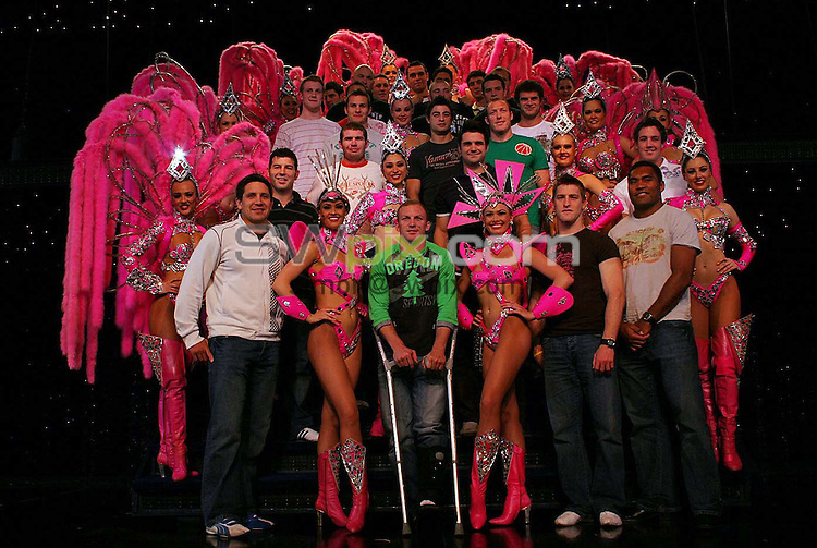 PIX: Rugby League. Tri-Nations. Australia rugby league squad in France, 7-8 November 2005...COPYRIGHT PICTURE>> SIMON WILKINSON>>0870 092 0092>>....The Australian rugby league squad with the Aussie contingent from the famous Moulin Rouge, in Paris. Of the thirty showgirls at the Pigalle district nightspot, half are from Australia.............