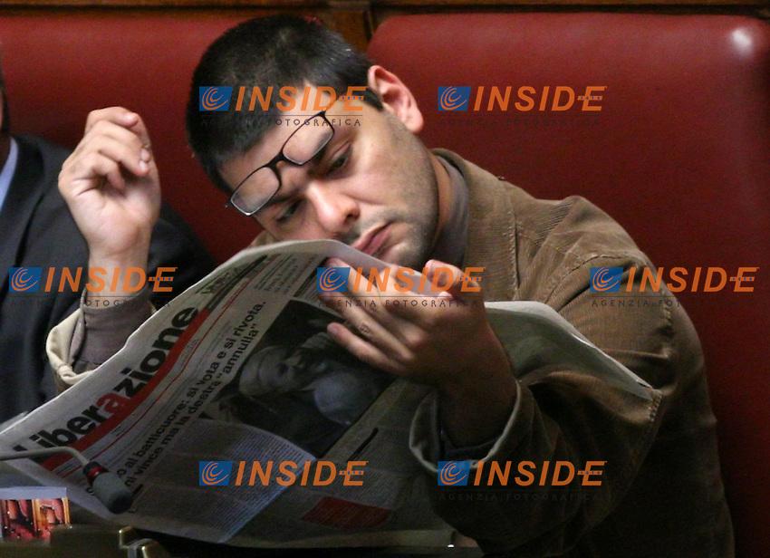 Roma, 29/04/2006 Camera:Votazione per il Presidente<br /> Nella foto il deputato di Rifondazione Comunista Francesco Caruso mentre legge il quotidiano Liberazione<br /> Photo Serena Cremaschi Insidefoto