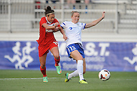 Boyds MD - April 19, 2014: Leigh Ann Robinson (13) of FC Kansas City goes against Jodie Taylor (14) of the Washington Spirit. The Washington Spirit defeated the FC Kansas City 3-1 during a regular game of the 2014 season of the National Women's Soccer League at the Maryland SoccerPlex.