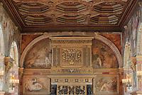Chimney Wall of the Ballroom or Galerie Henri II, with frescoes of allegories of Diana and hunting painted c. 1552 by Niccolo dell'Abatte after drawings by Primaticcio, including Sebastine de Rabutin killing a lynx (top left), Diana with Cerberus and Cupid (below left), Hercules and a wild boar of Erymanthus (top right), and Diana in a chariot pulled by dragons (bottom left), Chateau de Fontainebleau, France. The ballroom was started by Gilles le Breton under Francois I, completed by Philibert Delorme under Henri II. The Palace of Fontainebleau is one of the largest French royal palaces and was begun in the early 16th century for Francois I. It was listed as a UNESCO World Heritage Site in 1981. Picture by Manuel Cohen