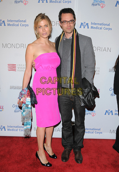 SONYA WALGER & DAVEY HOLMES.The Children Mending Hearts Benefit for International Medical Corps Relief Efforts in the Congo held at The House of Blues Sunset in West Hollywood, California, USA..February 18th, 2009.full length fluorescent strapless pink dress black shoes black scarf grey gray suit jacket jeans denim.CAP/DVS.©Debbie VanStory/Capital Pictures.
