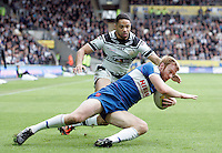 PICTURE BY VAUGHN RIDLEY/SWPIX.COM - Rugby League - Super League - Hull FC v Hull KR - KC Stadium, Hull, England - 06/04/12 - Hull FC's Will Sharp and Hull KR's David Hodgson.
