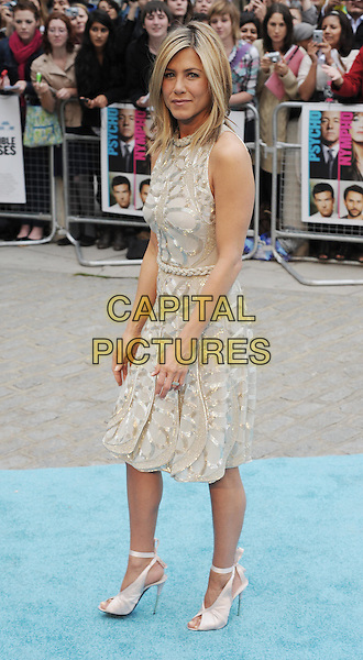 JENNIFER ANISTON.Horrible Bosses UK Premiere, BFI, London, England..20th July 2011.full length length white cream dress sheer gold folds folded pleats pleated sleeveless braid braided belt sequins sequined ribbon ankle shoes peep toe side.CAP/WIZ.© Wizard/Capital Pictures.